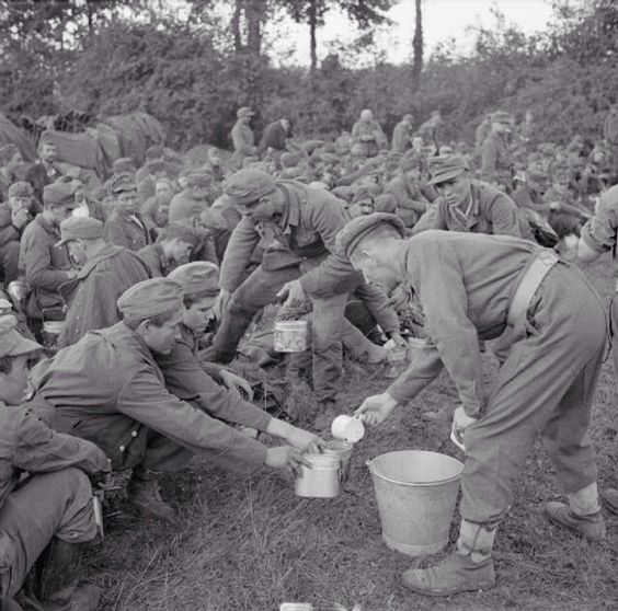 Tea is served to German prisoners in the Falaise pocket - France - 22 August 1944   [Panzer]