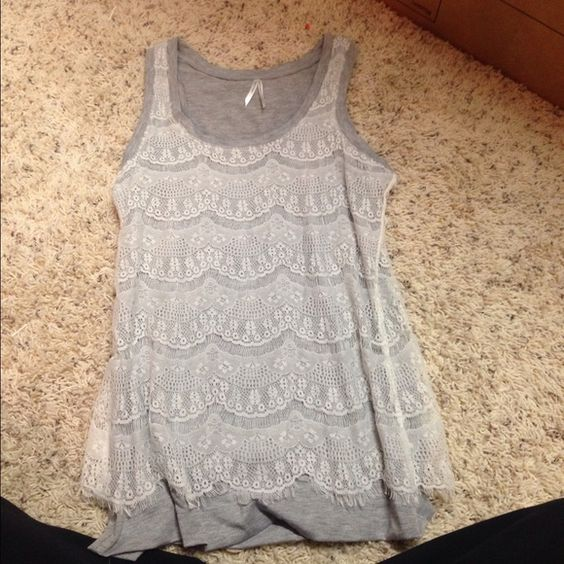Ivory lace and grey tank! Small ivory all over lace tank top with light grey covering underneath! Only worn a few times :) bundle to get a better deal or click the offer button!! Tops Tank Tops