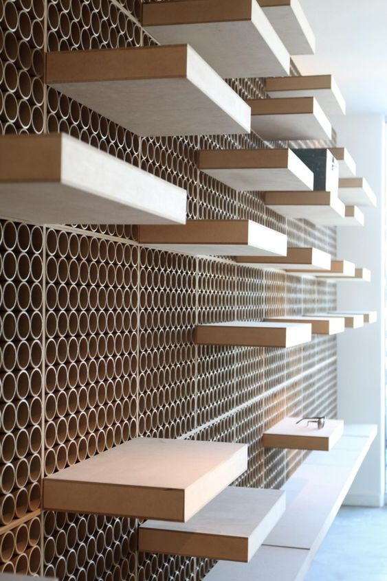 Hmm this and french cleats? Dr. York / DCPP Architects modules - MDF with recycled cardboard tubes, but PVC might be better.