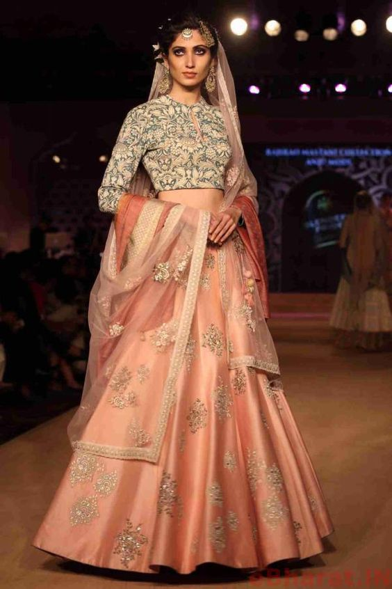 Grey top with peach lehnga for bride