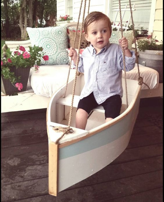 Handmade wooden boat swing. Hang it from a tree, a porch, or swing set. It measures 33 inches long by 17 inches wide. The rope is an all natural: