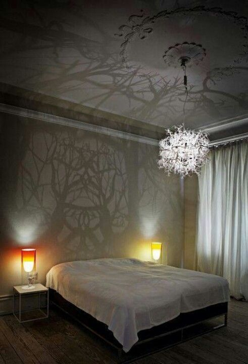 Awesome Do it yourself chandelier casting beautiful shadows and light in the bedroom.