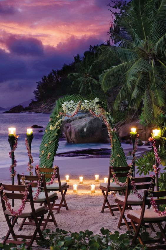 Beach wedding at Seychelles Four Seasons resort Seychelles. Choose from the simply bliss wedding package or the forever and ever wedding package. www.travelagentlongisland.com