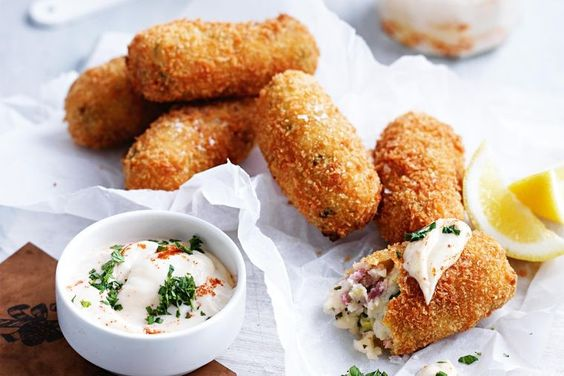 PEA AND HAM CROQUETTES WITH FIERY AIOLI: Turn leftover Christmas ham into finger food for a crowd with these tasty croquettes.
