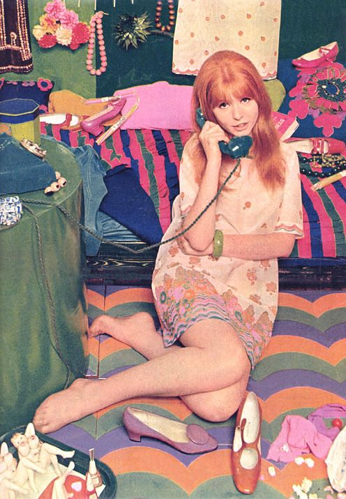 Jane Asher posing in a London boutique wearing a screen-printed paper minidress designed by Ossie Clark