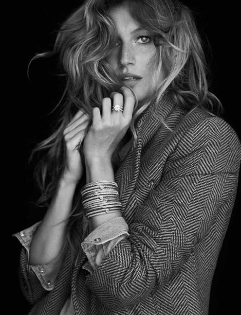 Gisele Bundchen wearing a DY Crossover engagement ring in platinum with diamonds; Silver Ice Labyrinth triple-loop cuff in sterling silver with diamonds, Double-Loop cuff in sterling silver with diamonds.