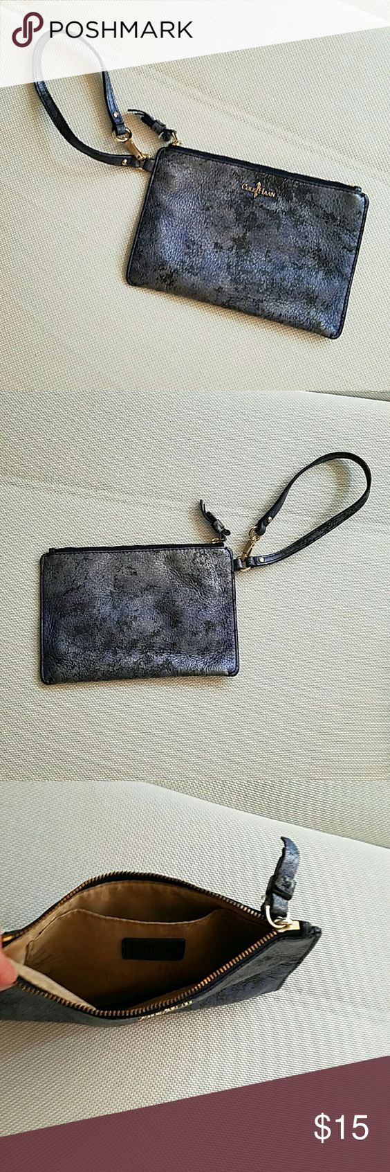 Cole Haan wristlet Blue speckled Cole Haan wristlet with zipper closure! 8 inches across and 5.5 inches vertically. Cole Haan Bags Clutches & Wristlets