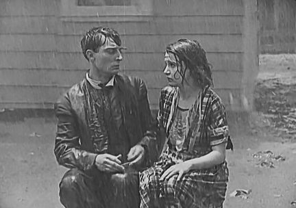 Buster Keaton in the rain. from Buster Keaton's One Week 1920