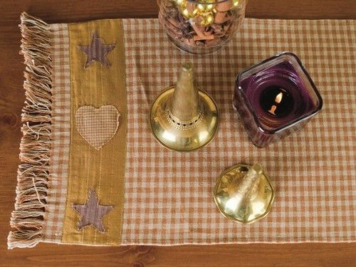 Have a beautiful harvest feel in your country dining room with this woven table runner.