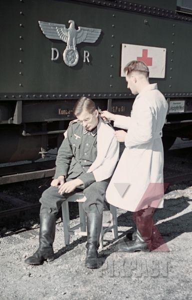 Wehrmacht soldier getting haircut near the Leipzig main station, Germany 1941
