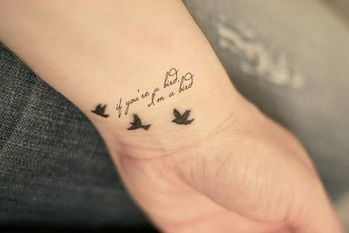 wrist tattoo:  Love the birds, not so much the saying..