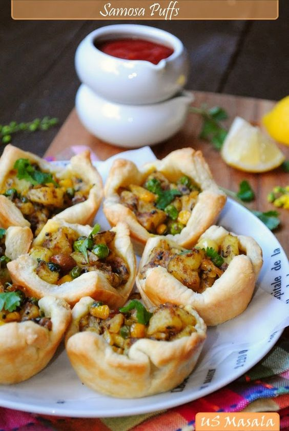 Samosa puffs. I've always wanted to make samosas but was intimidated by the pastry....this looks easy! Gonna try it