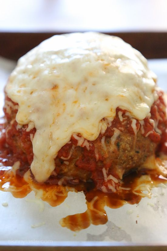 This isn't your regular meatball, it's HUGE, baked in the oven similar to how you would make a meatloaf, then topped with marinara and melted cheese – I'm OBSESSED!: