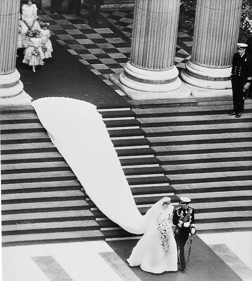 Princess Diana's wedding dress designed by David and Elizabeth Emanuel with a 25 foot wedding dress train.