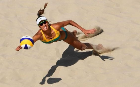 Taliqua Clancy of Australia dives for the ball during the Women's Beach…