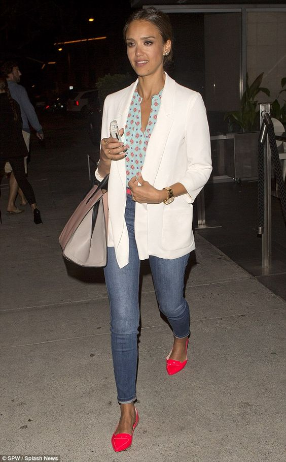 She's got that holiday glow! Jessica Alba looked healthy and radiant as she headed out of ...