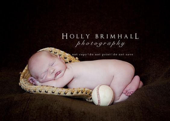 Baby in baseball glove