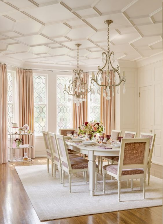 Elegant dining room with rosy pink and dramatic ceiling design. Beautiful Classically Refined Rooms on Hello Lovely Studio.