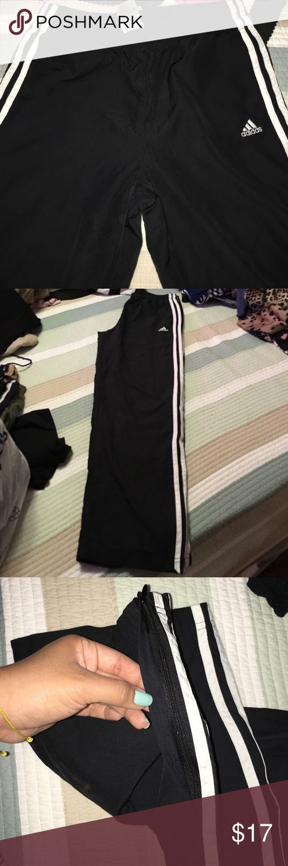 Pants Black adidas white strips on the side zippers on the bottom..wore 3times no more then that Adidas Pants Track Pants & Joggers