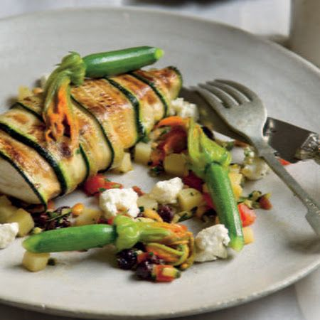 Zucchini-Wrapped John Dory (fish filet), Tomato, Pine Nuts and Steamed Zucchini Flowers