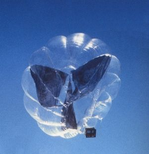 The air inside the balloon is heated by greenhouse effect and the black screens pick up the energy that has gone through the transparent polyester film.