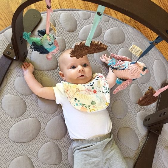Love how entrigued this wee girl is with her new @finnandemma play gym...while staying comfy on her @nooksleep lilypad, and soaking up that excited drool with our ultra absorbent bib! ALL of these items can be purchased locally at @momeasebabyboutique ! #finnandemma #playgym #playmat #lilypad #nook #nooksleepsystem #tummytime #babydevelopment #baby #bib #modern #organic #woodentoy thanks for letting me share @mrsslauder ! X