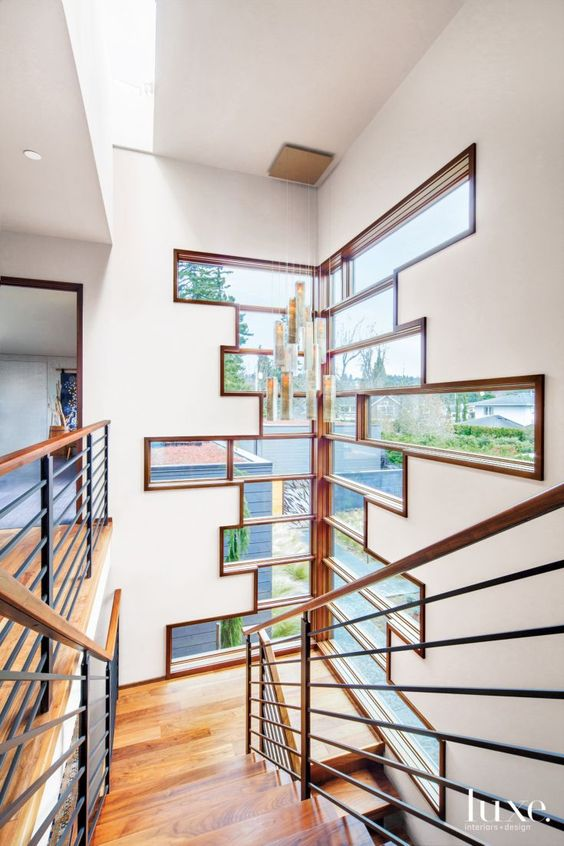 Contemporary cream stair tower with windows luxe halls for Stair tower