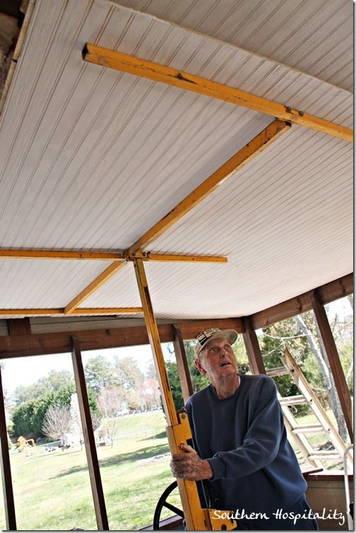 Installing bead board porch ceiling.