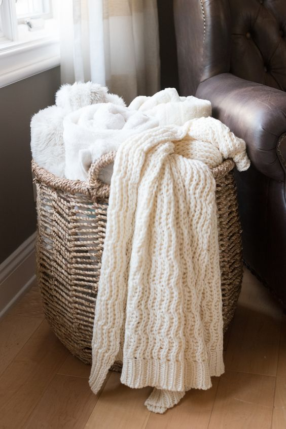 @homegoods basket filled with cozy throw blankets.  #HelloGorgeous