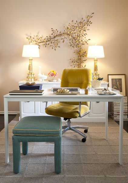 I love the combination of the cool aqua bench with the warm yellow chair.  It complements the mix of gold and silver finishes in the room.