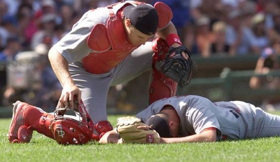 REMEMBERING DARRYL KILE-This weekend marks the 10yr anniversary of the saddest week in Cardinals history with the passing of Darryl Kile and Jack Buck.  In this pic-   catcher Mike Matheny moves to help  pitcher Darryl Kile after Kile was hit by a line drive hit by Chicago Cubs' Robert Machado in the fourth inning Friday, July 27, 2001 at Wrigley Field  RIP