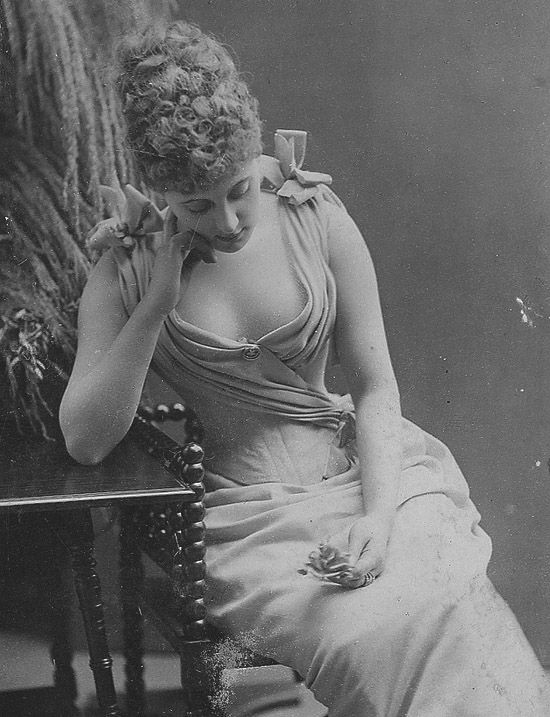 Seated woman in gown, late 1800s. Beautiful decolletage.: