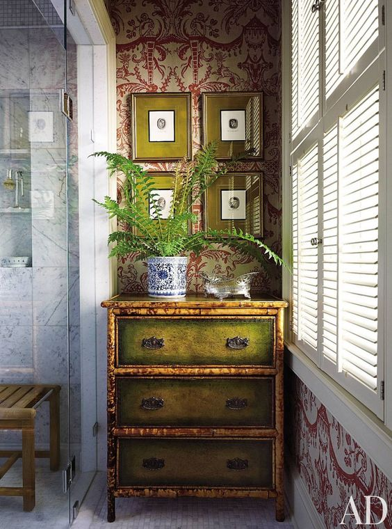 A 19th-century bamboo chest and antique geological engravings accent a bath