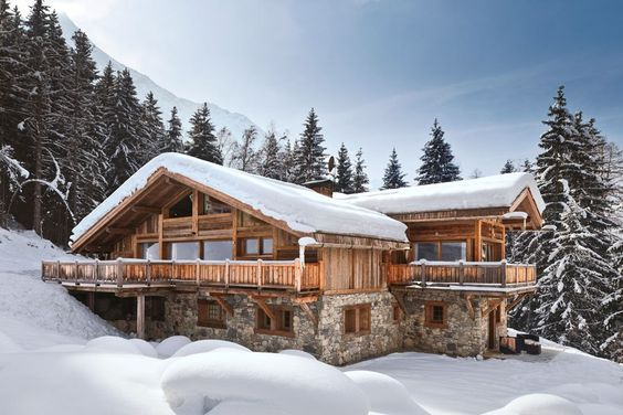 Nestled in the heart of the French Alps, this 2009 chalet in Chamonix, France, created by the local boutique design firm Prestige et Passion, is highlighted by a traditional stone-and-timber façade and interiors clad in wood planks.