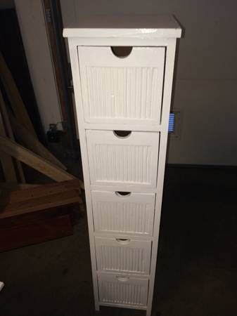 white wood storage cabinet with five drawers