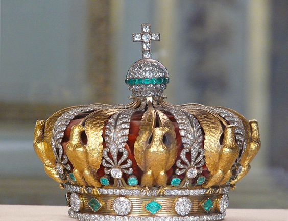 Empress Eugénie's Crown For the Paris Universal Exposition of 1855, Napoleon III decided to impress the whole world by exhibiting the Crown diamonds, which he had reset for the occasion. Alexandre-Gabriel Lemonnier (circa 1808-1884) was chosen to produce the crowns of the Emperor and of the Empress with part of these stones. The crown of the Empress, now in the Louvre. It has 2,480 diamonds and 56 emeralds