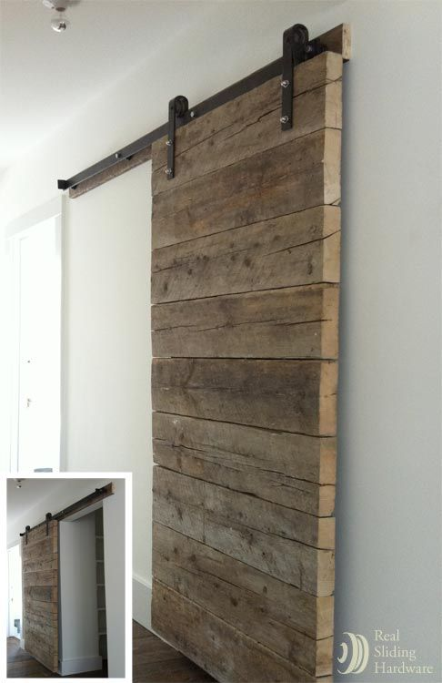 PERFECT... now i can toss my flimsy plastic folding door i put to close off my laundry utility room.... (glad I kept my old rollers off the mower to use as hardware.. buy rebar or plumbing pipe the right circum. to allow them to roll or slide on lighter version of this door)Custom plank door made from salvaged, job site planks.