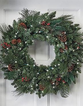 Adorn your front door with beautiful holiday spirit with the Classic Pre-lit Wreath.