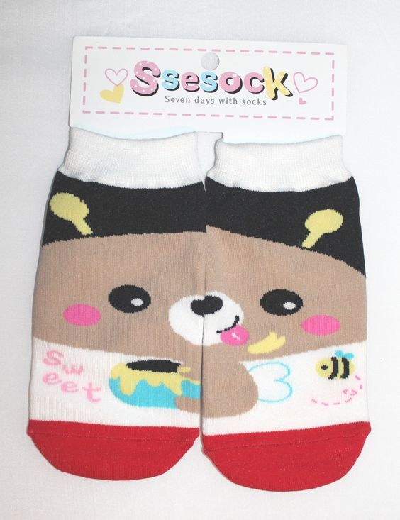 It's a cute pair of ankle socks with a brown bear picture on it.  Combine each half of the sock to make a complete picture!
