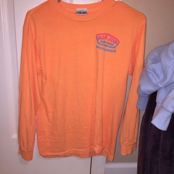 ron jon surf long sleeve t-shirt bought in myrtle beach. doesn't fit me right. never worn but washed once. size small. new condition. light orange color really cute Tops Tees - Long Sleeve