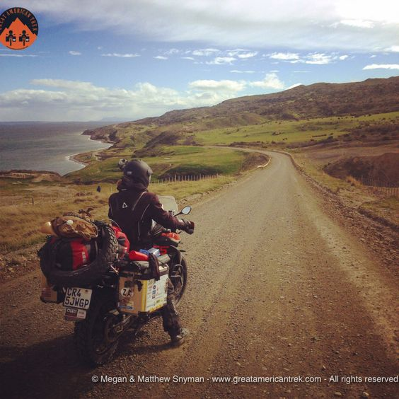 Megan riding the coastal road to Povinir in Tierra Del Fuego  2 doctors traveling by motorcycle Argentina to Alaska for Doctors Without Borders