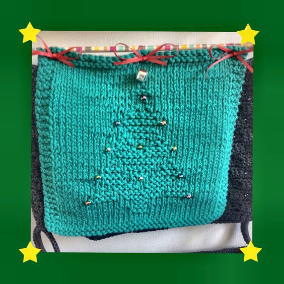 Hand Knit dishcloth ( added on bell and beads )  Pattern from : holiday knit dishcloth by  Catherine Satterfield