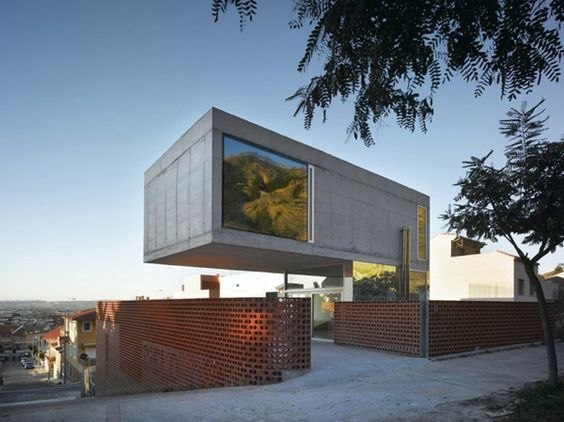 Cantilevered Concrete House by XPIRAL Architecture