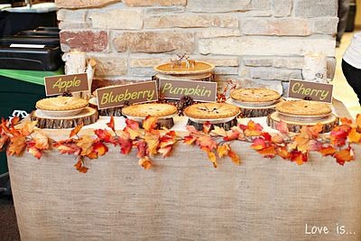 Pie buffet with the name tags using pinecones so fall themed wedding