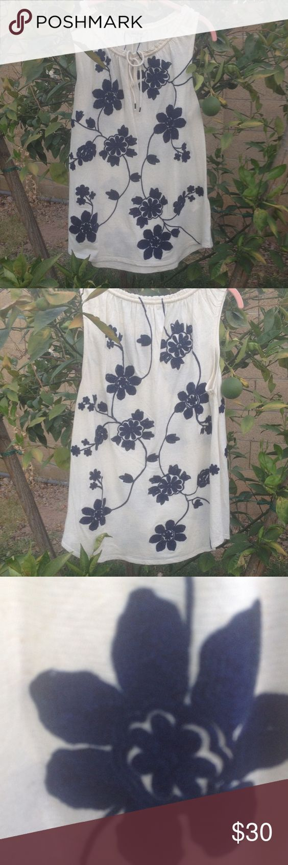 Lucky Brand sleeveless top NWT Lucky brand sleeveless top cream color with navy Blue embroidered flowers 66% cotton 28% viscose 6% linen embroidery is 100% acrylic NWT Lucky Brand Tops