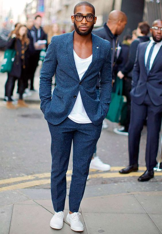 Tinie Tempah wearing t - shirt and suit