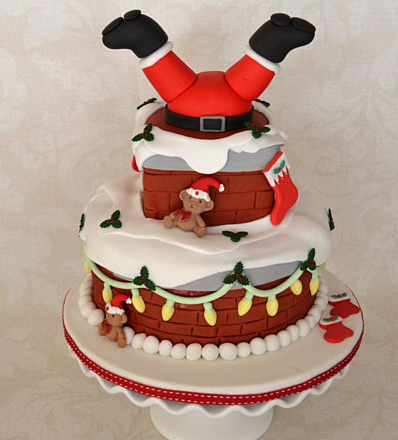 Upside down santa stuck in chimney christmas fruit cake Santa stuck in chimney cake