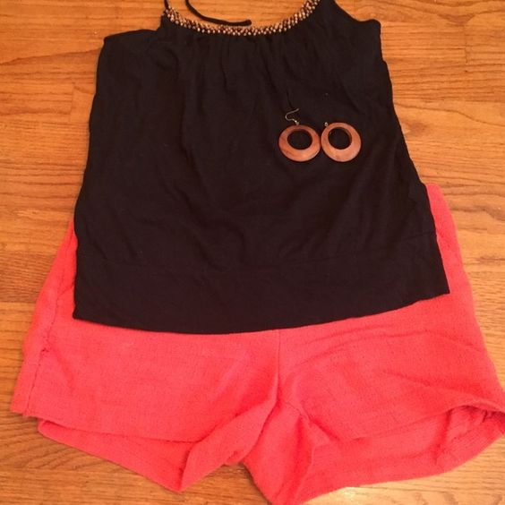 Black and orange isn't just for Halloween anymore! Beautiful coral eyelet shorts (size 8) paired with a black halter top that has a beaded accent neckline so don't worry about what necklace to wear.  It is finished off with the perfect pair of wooden earrings!  Like the outfit not the price... Hit the offer button! All reasonable offers will be accepted Tops Tank Tops
