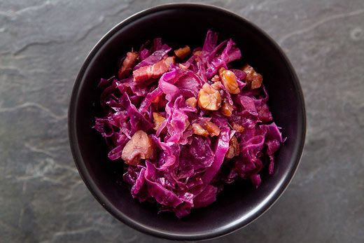 Sweet and sour red cabbage, cooked with bacon, apples, onions, and roasted chestnuts.