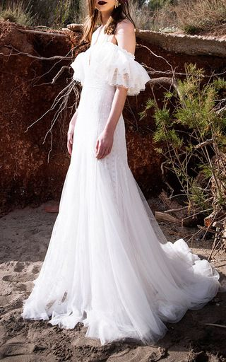 This **Costarellos** down features a ruffled off-the-shoulder neckline and tulle godets at the skirt.